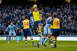 Olivier Giroud of Arsenal ans Fernando of Manchester City compete in the air - Photo mandatory by-line: Rogan Thomson/JMP - 07966 386802 - 18/01/2015 - SPORT - FOOTBALL - Manchester, England - Etihad Stadium - Manchester City v Arsenal - Barclays Premier League.