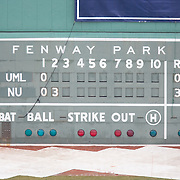 The Fenway Park scoreboard during the Frozen Fenway game between The Northeastern Huskies and The UMass Lowell Riverhawks at Fenway Park on January 11, 2014 in Boston, Massachusetts.
