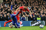 Eden Hazard of Chelsea is fouled by Emre Can of Liverpool during the Capital One Cup Semi Final 2nd Leg match between Chelsea and Liverpool at Stamford Bridge, London, England on 27 January 2015. Photo by David Horn.