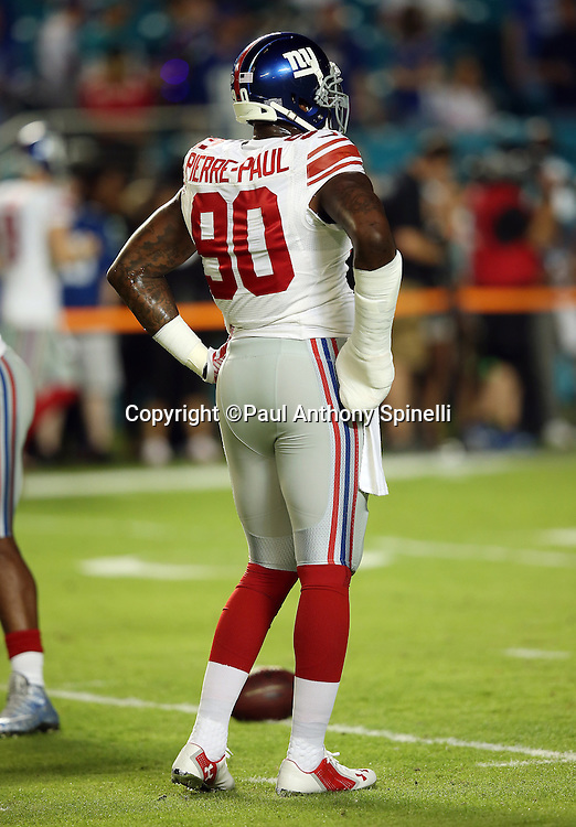 New York Giants defensive end Jason Pierre-Paul (90) looks on with his right hand bandaged due to a non-football injury during the NFL week 14 regular season football game against the Miami Dolphins on Monday, Dec. 14, 2015 in Miami Gardens, Fla. The Giants won the game 31-24. (©Paul Anthony Spinelli)