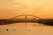 General view of Andalusia's longest river the Guadalquivir and the Puente de la Barqueta (Barqueta Bridge), Seville, Spain, pictured on January 3, 2007, at sunset. The bridge, designed by Juan J. Arenas and Marcos J. Pantaleon, was built 1989-92 to provide access to Expo 92. It is a suspension bridge, supported by a single overhead beam and spans 168 metres. Today the bridge is the main entrance to the Isla Magica theme park and Seville Tecnopolis. In this peaceful evening scene boats float on the Guadalquivir below the bridge. Picture by Manuel Cohen.