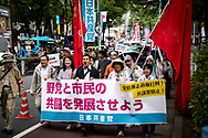 People hold a banner and shot slogan during the May Day rally in Tokyo on Monday, May 1, 2017, Thousands people participate demanding higher pays among other issues. 01/05/2017-Tokyo, JAPAN