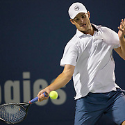 August 21, 2014, New Haven, CT:<br /> Andy Roddick hits a forehand during the Men's Legends Event on day seven of the 2014 Connecticut Open at the Yale University Tennis Center in New Haven, Connecticut Thursday, August 21, 2014.<br /> (Photo by Billie Weiss/Connecticut Open)