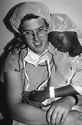The Orbis Flying Eye Hospital Recovery. Young girl comforted by surgeon after sight saving operation