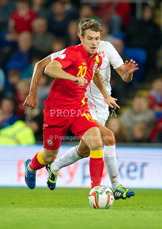 CARDIFF, WALES - Tuesday, September 10, 2013: Wales' captain Aaron Ramsey in action against Serbia during the 2014 FIFA World Cup Brazil Qualifying Group A match at the Cardiff CIty Stadium. (Pic by David Rawcliffe/Propaganda)