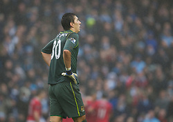 MANCHESTER, ENGLAND - Sunday, January 8, 2012: Manchester City's goalkeeper Costel Pantilimon looks dejected as Manchester United score the third goal during the FA Cup 3rd Round match at the City of Manchester Stadium. (Pic by Vegard Grott/Propaganda)