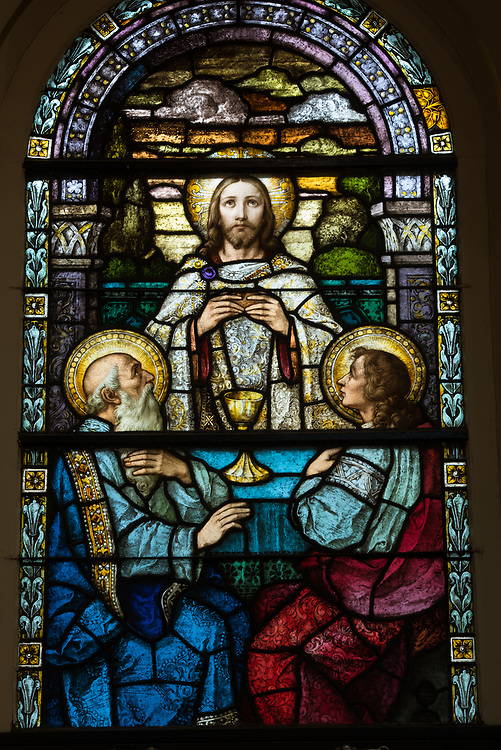 Stained glass window depicts Jesus meeting the two disciples on the road to Emmaus. (Sam Lucero photo)