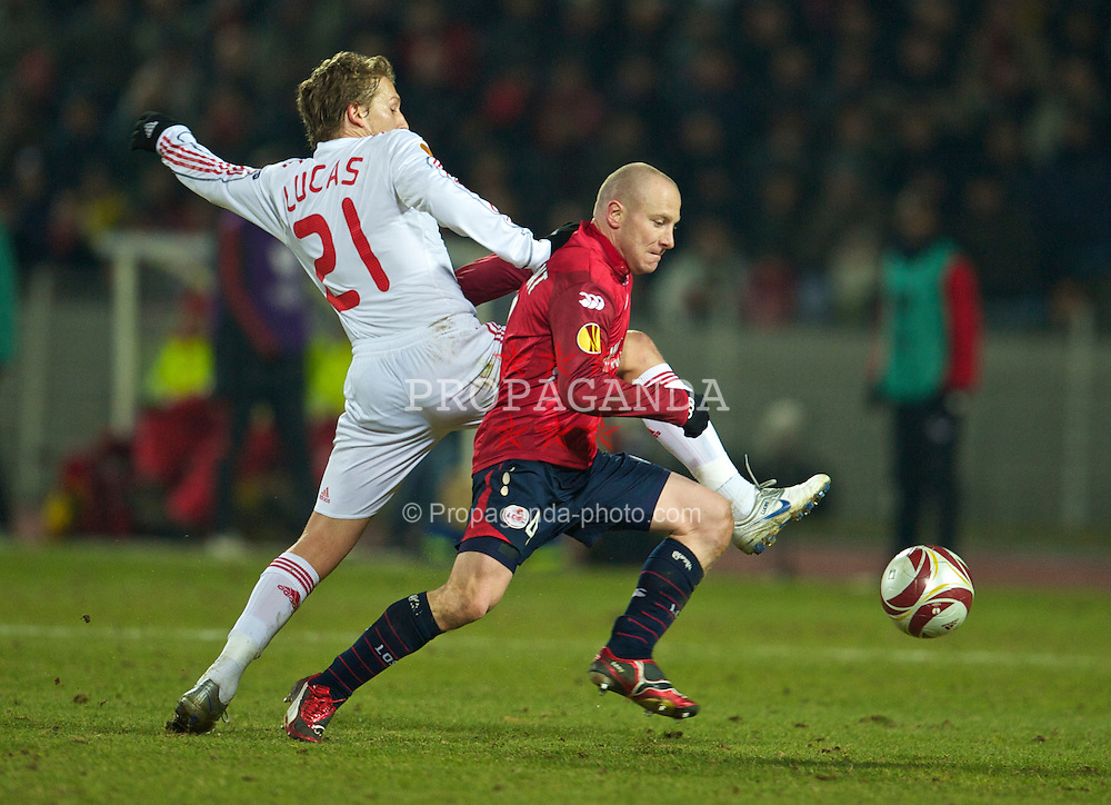 LILLE, FRANCE - Thursday, March 11, 2010: Liverpool's Lucas Leiva and LOSC Lille Metropole's Florent Balmont during the UEFA Europa League Round of 16 1st Leg match at the Stadium Lille-Metropole. (Photo by David Rawcliffe/Propaganda)