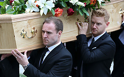 © Licensed to London News Pictures . 18/03/2016 . Manchester , UK . Alan Halsall and Mikey North help to carry the coffin in to the church. Television stars and members of the public attend the funeral of Coronation Street creator Tony Warren at Manchester Cathedral . Photo credit : Joel Goodman/LNP