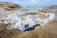 PICTURED ROCKS NATIONAL LAKESHORE - October 2016: Small waves wash up and swirl on the rocks in an area known as the coves. This is in the Beaver Basin Wilderness Area section of Pictured Rocks National Lakeshore and a short 1.5 mile hike from the Little Beaver Lake Campground.<br /> Photographer Bryan Mitchell was this years Artist in Residence at Pictured Rocks National Lakeshore in the Upper Peninsula of Michigan from Oct. 1-17, 2016 near Munising, Michigan. (Photo by Bryan Mitchell)