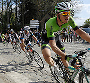 France April 13th 2014: The first group of riders pass through Gruson on the way to the finish in Roubaix Velodrome. Sep Vanmarcke, Belkin, is followed by John Degenkolb, Team Giant Shimano, Fabian Cancellara, Trek, Zdenek Stybar, Omega Pharma Quickstep, and Peter Sagan, Cannondale, through Gruson. Copyright 2014 Peter Horrell
