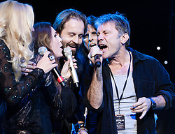 "© Licensed to London News Pictures. 16/09/2012. London, UK.  From L to R - Kerry Ellis, Sandi Thom, Alfie Boe, Alice Cooper and Bruce Dickinson performs at The Sunflower Jam at the Royal Albert Hall.  The Sunflower Jam is a British charity, founded by Jacky Paice, wife of Deep Purple drummer, Ian Paice. Other high-profile supporters are the actor Jeremy Irons, ex-Jamiroquai bassist Nick Fyffe and Charles, Prince of Wales. The aims of the charity are to fund complementary therapists and spiritual healers to work on cancer wards in the British National Health Service. After setting up a meeting between members of Deep Purple and a young boy dying of leukemia, Paice saw ""all the good work the healers were doing"" and decided ""lets find a way to raise money to get more healers in there. Photo credit : Richard Isaac/LNP"