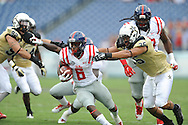 Ole Miss Rebels running back Jaylen Walton (6) runs 20 yards for a first quarter touchdown against Vanderbilt Commodores linebacker Darreon Herring (35) at L.P. Field in Nashville, Tenn. on Saturday, September 6, 2014. Ole Miss won 41-3.