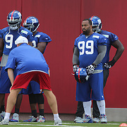 Cullen Jenkins, (right, 99), listens to his coach at a training drill during the 2013 New York Giants Training Camp at the Quest Diagnostics Training Centre, East Rutherford, New Jersey, USA. 29th July 2013. Photo Tim Clayton. l.