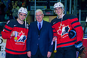 KELOWNA, CANADA - JANUARY 17:  Bruce Hamilton presents Dillon Duke and Cal Foote their Gold Medals from the 2018 IIHF World Junior Tournament at the Kelowna Rockets game on January 17, 2018 at Prospera Place in Kelowna, British Columbia, Canada.  (Photo By Cindy Rogers/Nyasa Photography,  *** Local Caption ***