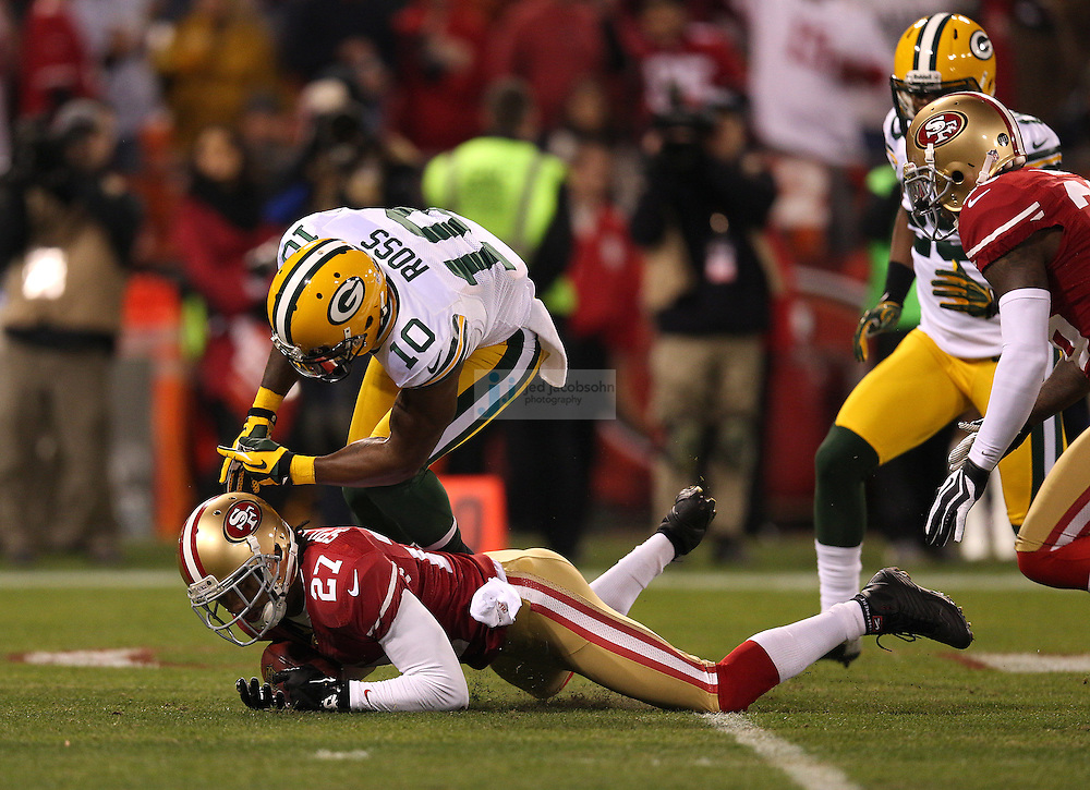 Green Bay Packers wide receiver Jeremy Ross (10) fumbles the ball as San Francisco 49ers defensive back C.J. Spillman (27) recovers the ball during a NFL Divisional playoff game against the Green Bay Packers and the San Francisco 49ers at Candlestick Park in San Francisco, Calif., on Jan. 12, 2013. The 49ers defeated the Packers 45-31. (AP Photo/Jed Jacobsohn)