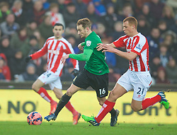 STOKE-ON-TRENT, ENGLAND - Sunday, January 4, 2015: Wrexham's Wes York in action against Stoke City's Steve Sidwell during the FA Cup 3rd Round match at the Britannia Stadium. (Pic by David Rawcliffe/Propaganda)