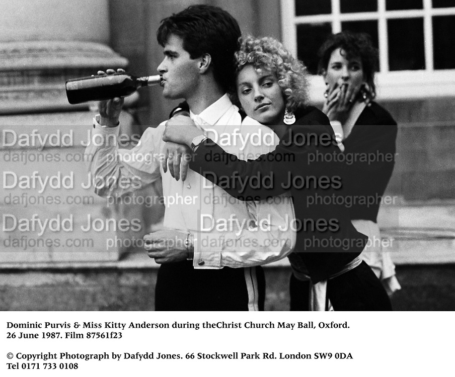 Dominic Purvis & Miss Kitty Anderson during theChrist Church May Ball, Oxford. 26 June 1987. Fillm 87561f23<br />© Copyright Photograph by Dafydd Jones<br />66 Stockwell Park Rd. London SW9 0DA<br />Tel 0171 733 0108