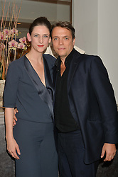 MARIA GRACHVOGEL and her husband MIKE SIMCOCK at a dinner to celebrate 20 years of Maria Grachvogel's fashion label held at Salmontini, 1 Pont Street, London on 22nd October 2014.