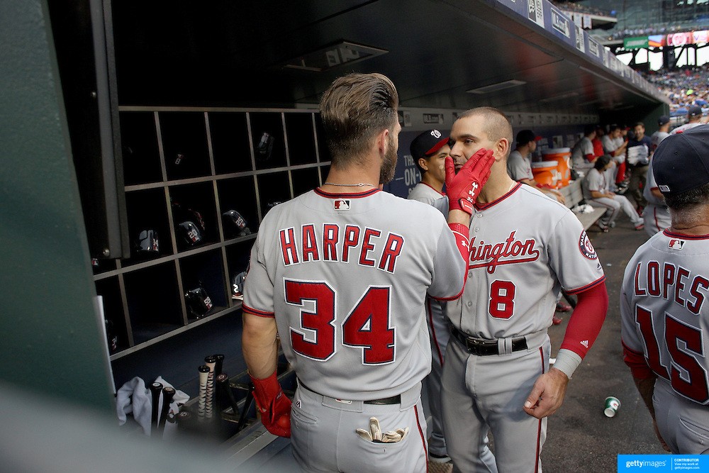 NEW YORK, NEW YORK - July 07: Bryce Harper #34 of the Washington Nationals and Danny Espinosa #8 of the Washington Nationals slap faces in a pre game ritual before the Washington Nationals Vs New York Mets regular season MLB game at Citi Field on July 07, 2016 in New York City. (Photo by Tim Clayton/Corbis via Getty Images)