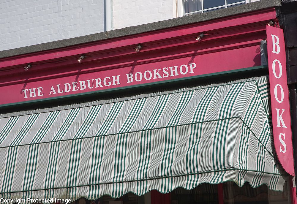 Bookshop sign above shop awning, Aldeburgh, Suffolk, England