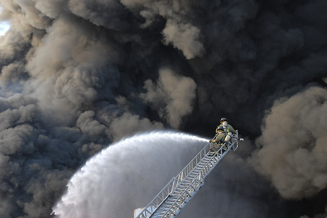 Feb. 11: A firefighter battles a massive blaze in unincorporated Fulton County.