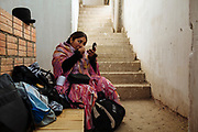 Maria Eugenia Herrera Mamani, alias &ldquo;Claudina the Cursed&rdquo;, makes herself up in the dressing room of the Community Center El Alto where wrestling show take place all Sundays. The Cholitas wear the traditional costumes of Aymara people during wrestling shows, El Alto, Bolivia, February 26, 2012.<br /> SPANISH: Mar&iacute;a Eugenia Mamani Herrera, alias Claudina La Maldita se maquilla el rostro en el &aacute;rea de vestidores ubicado en la parte trasera del Multifuncional El Alto donde cada domingo se presenta el espect&aacute;culo de lucha libre. Las Cholitas usan la vestimenta tradicional de los Aymara cuando entran al ring a luchar, en El Alto, Bolivia, el 26 de Febrero de 2012.