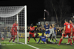 Wimbledon's Adebayo Akinfenwa scores a goal. - Photo mandatory by-line: Dougie Allward/JMP - Mobile: 07966 386802 - 05/01/2015 - SPORT - football - London - Cherry Red Records Stadium - AFC Wimbledon v Liverpool - FA Cup - Third Round
