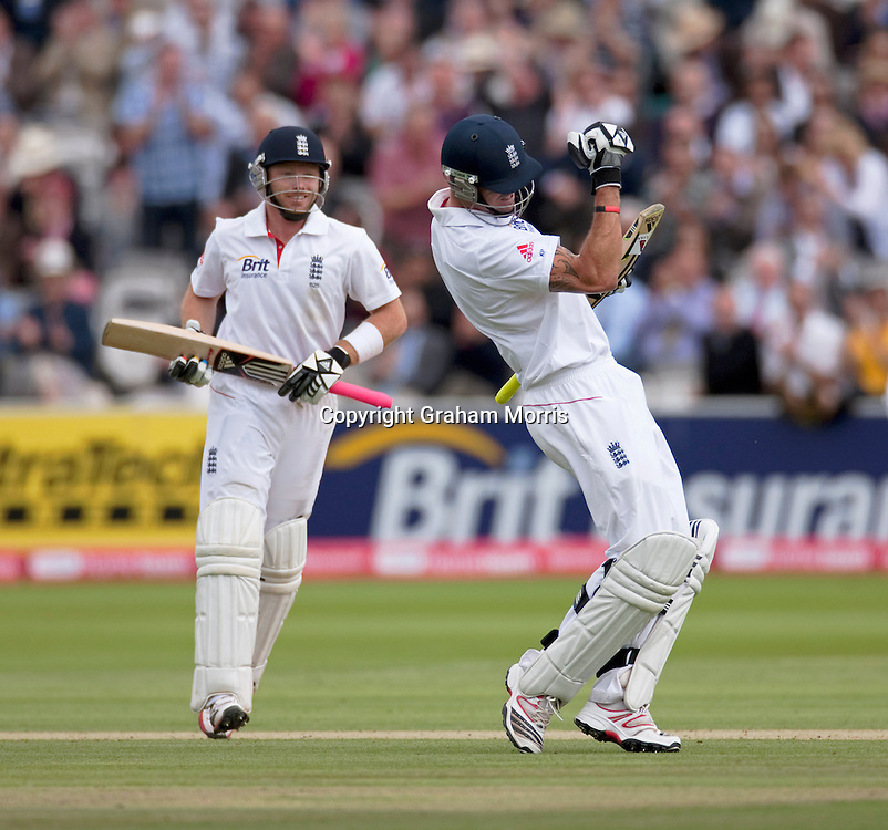 Kevin Pietersen celebrates his century (with Ian Bell) during the first npower Test Match between England and India at Lord's Cricket Ground, London.  Photo: Graham Morris (Tel: +44(0)20 8969 4192 Email: sales@cricketpix.com) 22/07/11