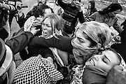 Demonstrators clash with Israeli military forces in the West Bank village of Nabi Saleh. Dec. 7, 2013. West Bank, Palestine.