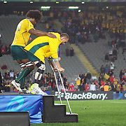 An injured Quade Cooper, Australia, on crutches, is helped from the stage by Radike Samo during the Australia V Wales Bronze Final match at the IRB Rugby World Cup tournament, Auckland, New Zealand. 21st October 2011. Photo Tim Clayton...