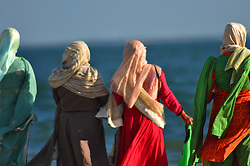 Bangladesh Women. Men, Children Having Fun at the Beach