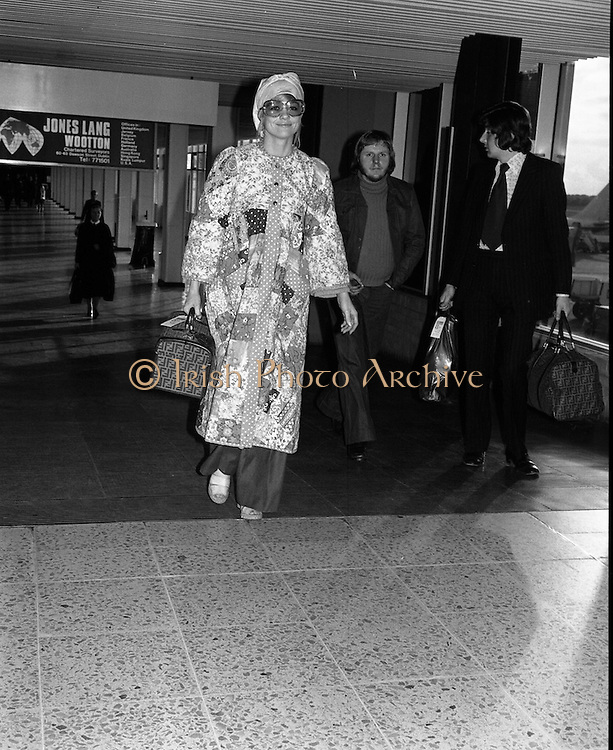 "Arrivals of Eric Clapton and Judy Geeson at DAP..1975..13.09.1975..09.13.1975..13th September 1975..Today saw the arrivals of musician Eric Clapton and actress Judy Geeson at Dublin Airport. They are in Ireland to take part in ""Circasia 75"" at Straffan House,Co Kildare..Image shows Judy Geeson,looking resplendent in a patchwork coat,arriving at Dublin Airport."