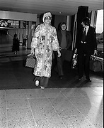 """Arrivals of Eric Clapton and Judy Geeson at DAP..1975..13.09.1975..09.13.1975..13th September 1975..Today saw the arrivals of musician Eric Clapton and actress Judy Geeson at Dublin Airport. They are in Ireland to take part in """"Circasia 75"""" at Straffan House,Co Kildare..Image shows Judy Geeson,looking resplendent in a patchwork coat,arriving at Dublin Airport."""