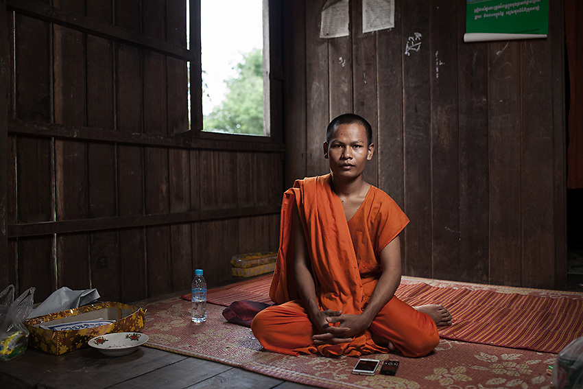 Old Kong, 24, is the oldest of the two monks living in Kbal Romeas. Having access to internet, he's been researching about the dam project, explaining to the villagers what they really are going to face.<br /> &quot;People here have always been self-sufficient; everybody built their own house and farmed their own animals. They're not used to money and they won't know how to start over in the relocation site. They're forcing us to leave and we eventually will but just with our bodies. Our spirits are not ready yet&quot;.