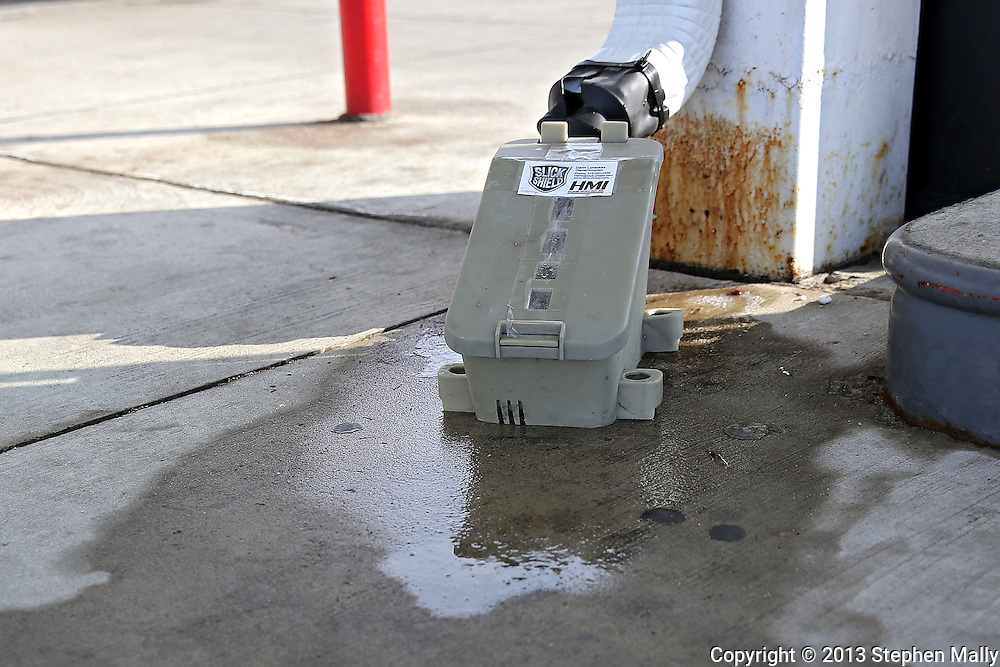 A Slick Shield installed on a down-spout at Hawkeye Convenience Store in Hiawatha on Monday, February 25 2013.