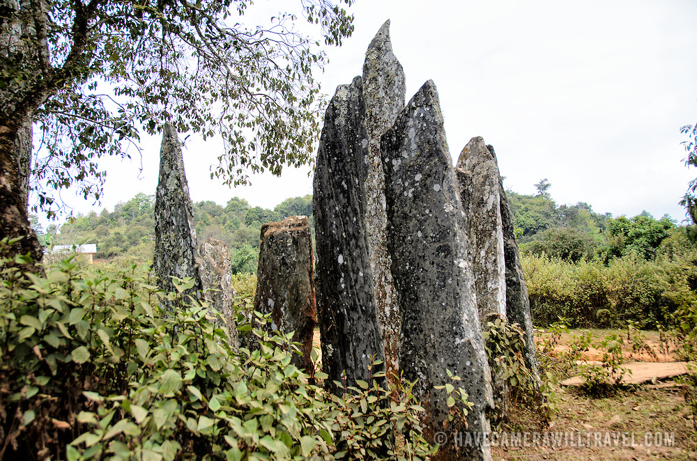 The menhirs (standing stones) or Hintang, near Sam Neua, in northeast Laos. The origin of the stones and the round stone covers is unknown, but they are presumed to be related to burial rituals, similar to the stone jars in the Plain of Jars. The stones were first studied by Madeleine Colani, a French archeologist, in the 1930s as part of her broader work on the megalithic stone jars that give the Plain of Jars their name.