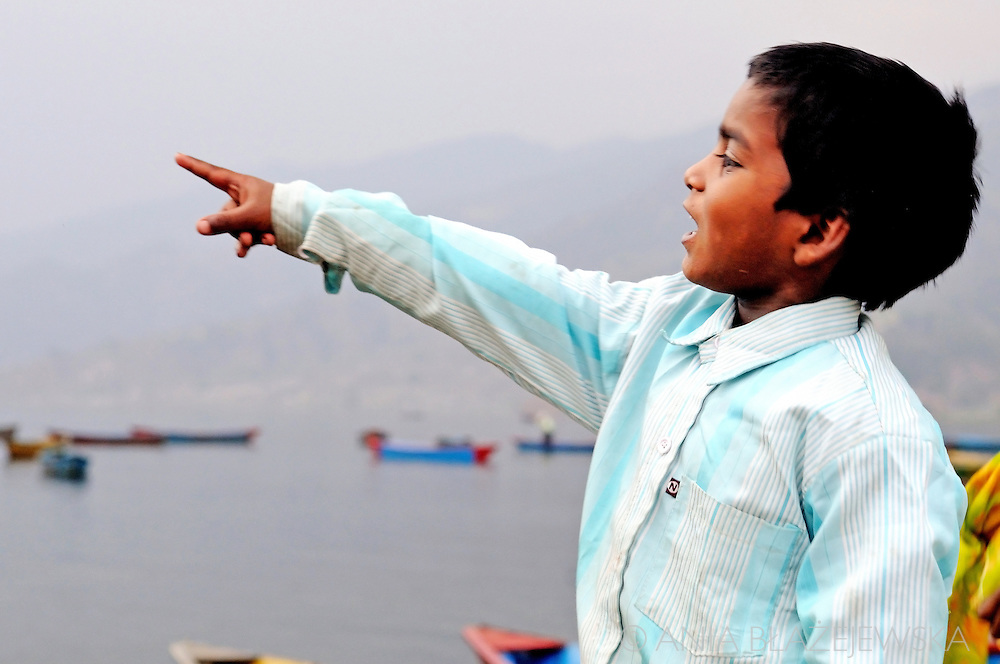Nepal, Pokhara. Nepalese boy showing something with his finger.