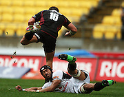 Harbour's James Hansen leaps over the tackle of Victor Vito.<br /> Air NZ Cup - Wellington Lions v North Harbour at Westpac Stadium, Wellington, New Zealand. Saturday 17 October 2009. Photo: Dave Lintott/PHOTOSPORT
