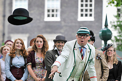 © Licensed to London News Pictures. 15/07/2017. London, UK. People take part in the Chap Olympiad in Bedford Square.  The eccentric festival sees participants in fancy outfits compete in events that require minimum physical exertion amidst the atmosphere of a summer garden party. Photo credit : Stephen Chung/LNP