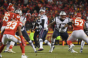 Jan 20, 2019; Kansas City, MO, USA; New England Patriots quarterback Tom Brady (12) looks down field to throw the football during the AFC Championship game at Arrowhead Stadium. The Patriots defeated the Chiefs 37-31 in overtime to advance to their fifth Super Bowl in eight seasons. (Robin Alam/Image of Sport)
