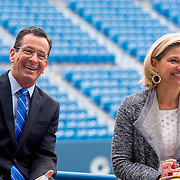 June 9, 2015, New Haven, CT:<br /> Connecticut Governor Dannel P. Malloy and Tournament Director Anne Worcester laugh during a press conference at the Connecticut Tennis Center to announce the new Connecticut Open 50/50 Project and the renewal of United Technologies sponsorship of the tournament through the 2017 in New Haven, Connecticut Tuesday, June 9, 2015.<br /> (Photo by Billie Weiss/Connecticut Open)