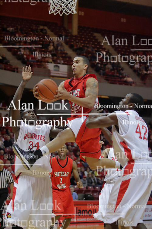 28 November 2009: Sam Pearson sails to the hoop between Tony Lewis and Dinma Odiakosa. The Redhawks of SouthEast Missouri State fall the Redbirds of Illinois State 93-53 on Doug Collins Court inside Redbird Arena in Normal Illinois.
