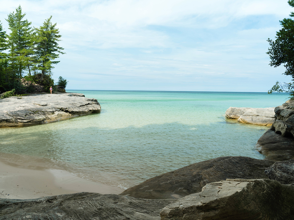 "A girl walking at The Cove. Image from the area known as ""The Cove,"" Pictured Rocks National Lakeshore, Michigan, USA."