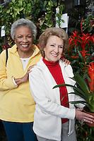 Two senior women in garden center