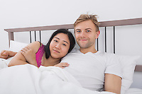 Portrait of loving couple in bed