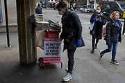 As the effects of Coronavirus continues to close down businesses and places of entertainment, and because of the governments's urge for home-working and avoidence of social gatherings, the West End of the UK's capital is unusually quieter than normal on a mid-week evening. On the day that the death toll reached 104 and that British schools would close indefinitely from the end of the week, the Evening Standard newspaper headlines at Leicester Square tube station with central London being the UK's pandemic hotspot, on 18th March 2020, in London, England.