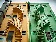 13 DECEMBER 2018 - SINGAPORE: Stairs going into apartments in shophouse buildings in the Geylang neighborhood. The original shophouses of Singapore are disappearing. Some are being torn down to make way for high rise developments, others are being gentrified into touristy shops and restaurants. The Geylang area of Singapore, between the Central Business District and Changi Airport, was originally coconut plantations and Malay villages. During Singapore's boom the coconut plantations and other farms were pushed out and now the area is a working class community of Malay, Indian and Chinese people. In the 2000s, developers started gentrifying Geylang and new housing estate developments were built.     PHOTO BY JACK KURTZ
