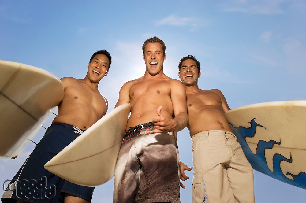 Smiling Surfers Giving Hang Loose Sign