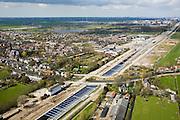 Nederland, Noord-Holland, Abcoude, 16-04-2008; aquaduct voor de spoorlijn Amsterdam-Utrecht onder het riviertje het Gein; het vrijstaande witte gebouw (links)  is het voormalige station; de spoorlijn is verdubbeld, Abcoude heeft een nieuwe station (eigenlijk halte) gekregen voor forenzen - midden rechts; forens, spoorverdubbeling, spoorbaan, officiele naam voor het bouwwerk het Rien Nouwen Aquaduct; links de dorpskern met kerk, aan de horizon Amsterdam met rechts Zuidoost rond het AMC (Bullewijk)..luchtfoto (toeslag); aerial photo (additional fee required); .foto Siebe Swart / photo Siebe Swart.